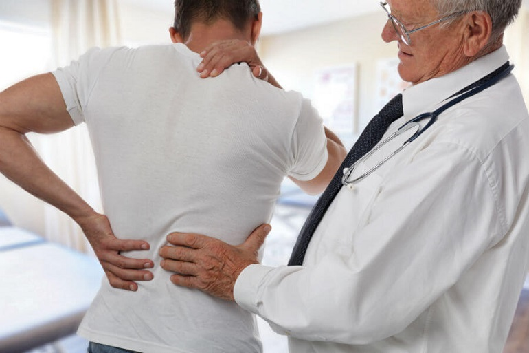 doctor-examining-back-injury-social